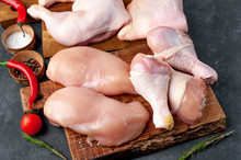 Raw Chicken Meat With Various Parts Of Fillet, Wings, Thighs On Concrete Background
