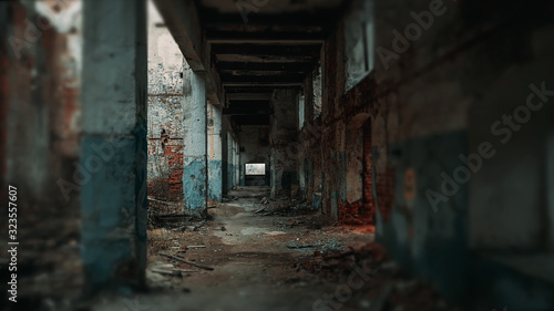 Long corridor of ruined abandoned eerie pillar industrial building with blurred Canvas Print