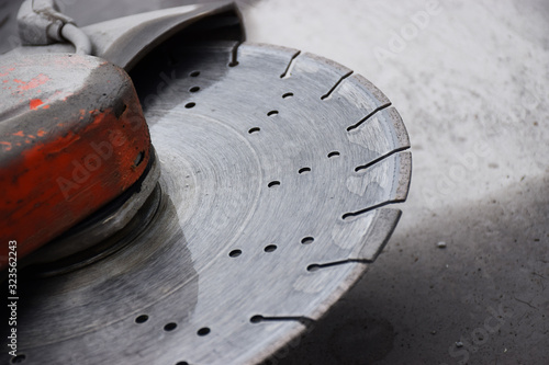 Papel de parede Concrete cutter machinery and cutting blade on a driveway