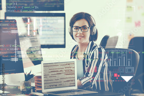 Stampa su Tela Female programmer working in office