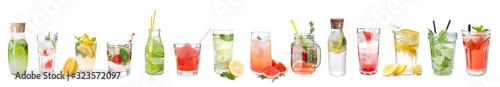 Photo Different tasty lemonades on white background