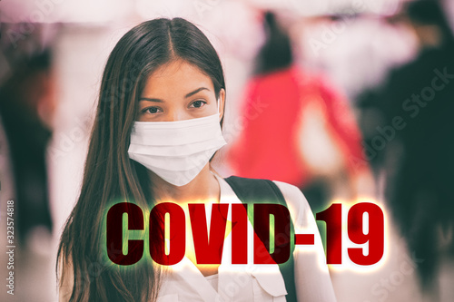 COVID-10 Sign with header text over Asian chinese woman tourist wearing face surgical mask as protection for Coronavirus during travel at airport. - 323574818