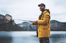 Fishery Concept, Beard Fisherman Hold In Hands Fishing Rod, Man Enjoy Hobby Sport On Lake, Person Catch Fish On River On Background Mount, Holiday Relaxation Vacation