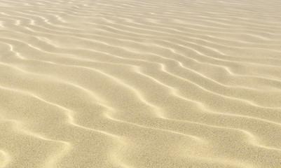 Wavey sand on beach under sunlight close-up