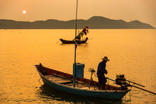Chanthaburi, Thailand - February, 02,  2020 :Beautiful Sunrise Over Sea With Silhouette Of Fishermen With Yellow And Orange Sun In The Background.