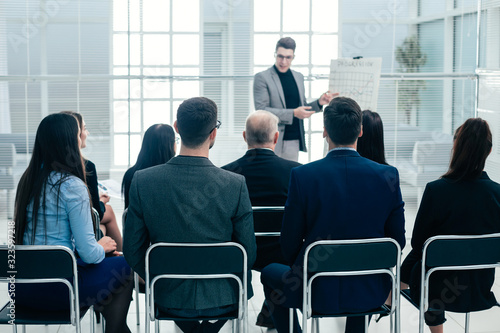 audience listens to the lecturer in the conference room - 323597218