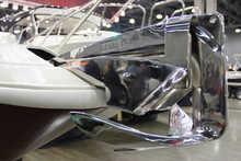 Shiny Stainless Steel 7.5 Kg Anchor With Roller On Forepeak Of A Motor Boat