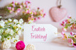 canvas print picture - Label With German Text Endlich Fruehling Means Hello Spring. Rose And White Flowers With Heart Decoration.