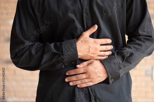 Valokuvatapetti sick man suffering from stomachache; concept of stomachache, stomach cancer, int