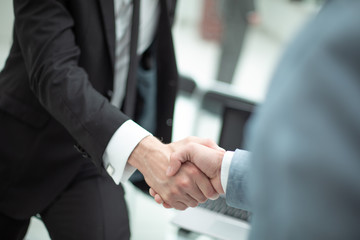 handshake of business people in the office background