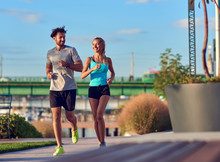 Modern Woman And Man Jogging /...