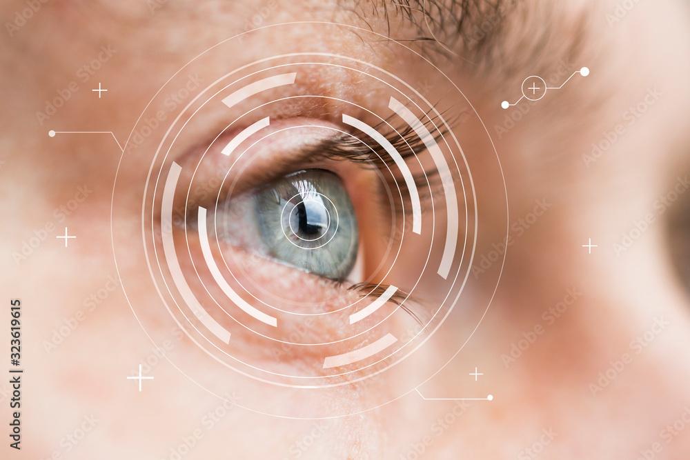 Fototapeta Eye monitoring and treatment in medical. Biometric scan of male eye closeup.