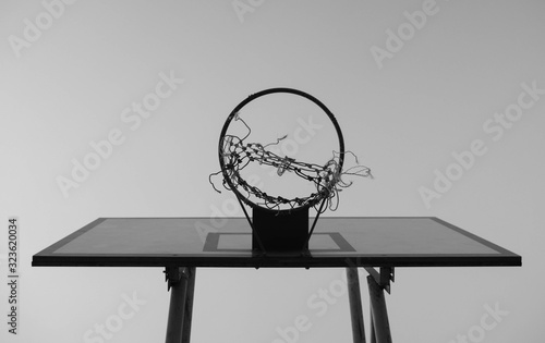 Canvastavla Black and white tone of Old basketball hoop on sky background in the public stadium