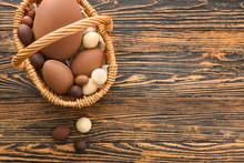 Basket With Tasty Chocolate Ea...
