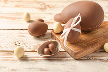 Tasty Chocolate Easter Eggs On Wooden Background