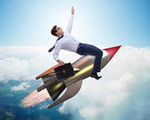 Businessman Flying On Rocket I...