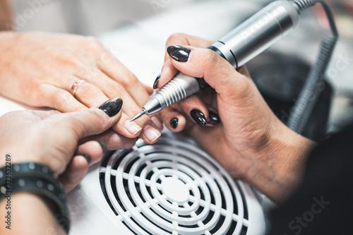 Closeup shot of hardware manicure in a beauty salon.