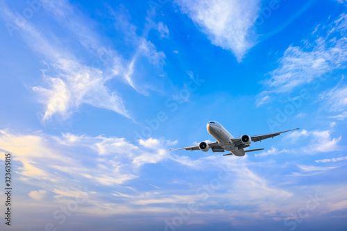 High-altitude airplane and beautiful sky in spring Wallpaper Mural