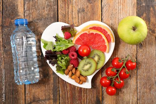 Fototapeta diet food concept with fruit, almond, apple and water bottle obraz na płótnie
