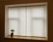 Pleated Blinds XL Coulisse, Beige Color, With 50mm Fold Closeup In The Window Opening In The Interior. Home Blinds - Modern Bottom Up Privacy Shades On Apartment Windows. Closed.