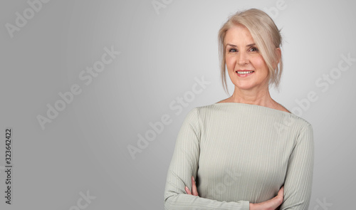 Fotografía Senior blonde woman is smiling isolated
