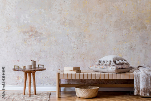 Fototapeta Minimalistic composition of oriental living room with chaise longue, small wooden coffee table, pillows, plaid, books and elegant personal accessories. Grunge wall Interior design Home decor  Template obraz