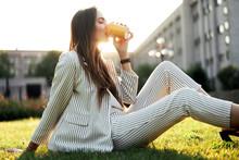 Young Stylish Woman Drinking C...