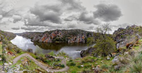 Panoramic view of Cloudy landscape with river and cliffs in Arribes del Duero. Spain. The Arribes del Duero Natural Park.