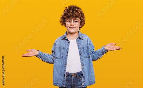 Cheerful cute boy making decision