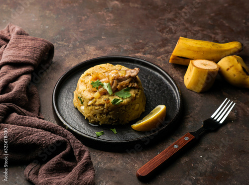 Mofongo, mashed  boiled plantains with porc meat, onion Canvas Print