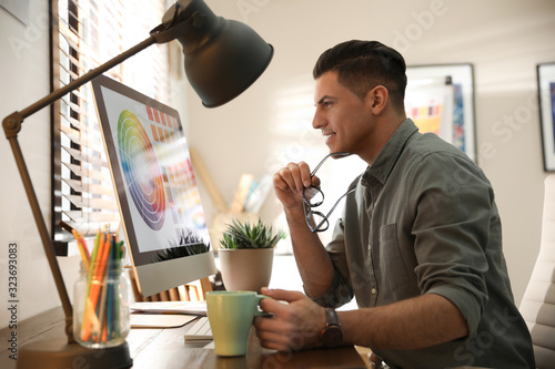 Professional designer working with computer in office