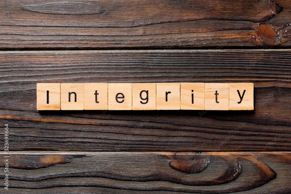 Fototapeta integrity word written on wood block. integrity text on table, concept