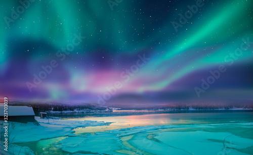Fototapeta Northern lights (Aurora borealis) in the sky over Tromso, Norway