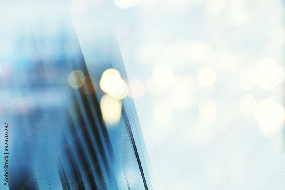 Fototapeta Abstract business modern city urban futuristic architecture background, motion blur, reflection in glass of high rise skyscraper facade, toned blue picture with bokeh. Real estate concept