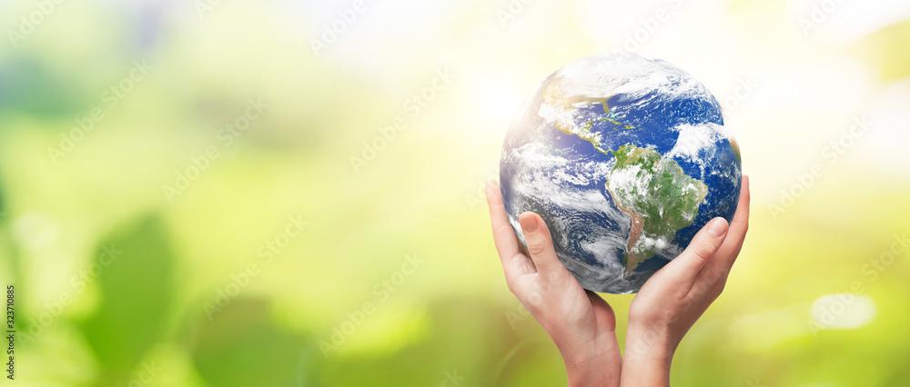 Fototapeta Earth globe in family hands. World environment day