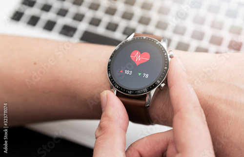 Fototapeta Hands with heart icon on smartwatch obraz