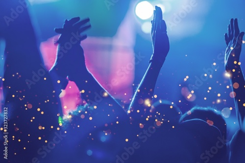 Audience with hands raised at a music festival