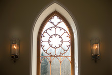 Large Arched Window Detail Looking Out Into A Garden Or Forest. Antique Window Detail. An Ancient Window On Facade