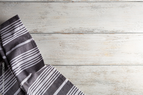 Fototapeta Kitchen cloth on white wooden table overhead view obraz
