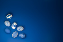 Easter Eggs With Different Textures In Classic Blue On A Seamless Blue Background. High Angle View