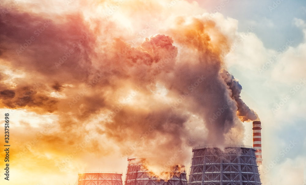 Fototapeta Air pollution smog from power factory plant chimneys smoking pipe sunset. Concept industry environmental problems