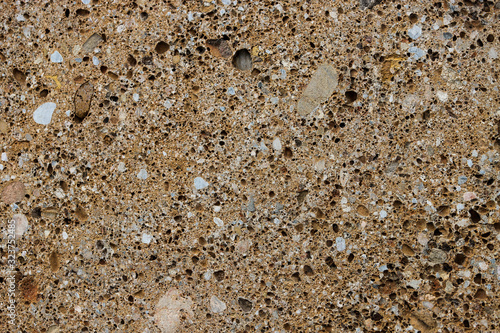 Fotografija Background texture of conglomerate stone with many pores and holes