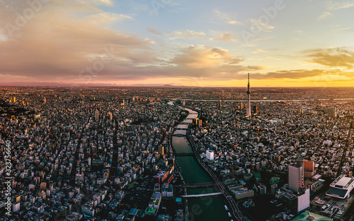 Dramatic sunrise sky of Tokyo cityscape at dawn, Japan - 323756640