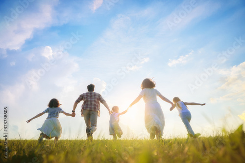 Happy family on summer walk - 323758606