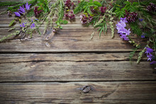 Wildflowers On Dark Old Wooden...