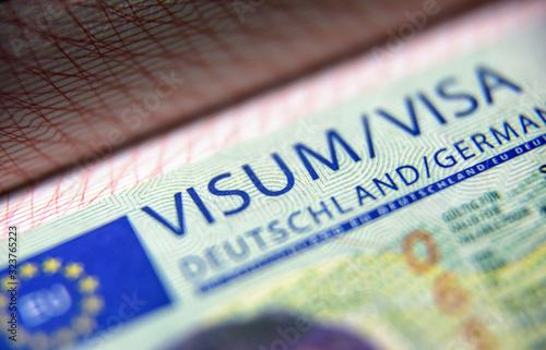 Obraz na plátně Visa stamp in passport close-up