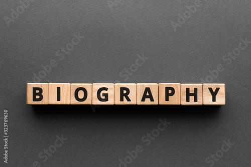 Photo Biography - words from wooden blocks with letters, the life story biography conc