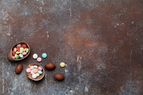 Easter greeting card backdrop with chocolate eggs