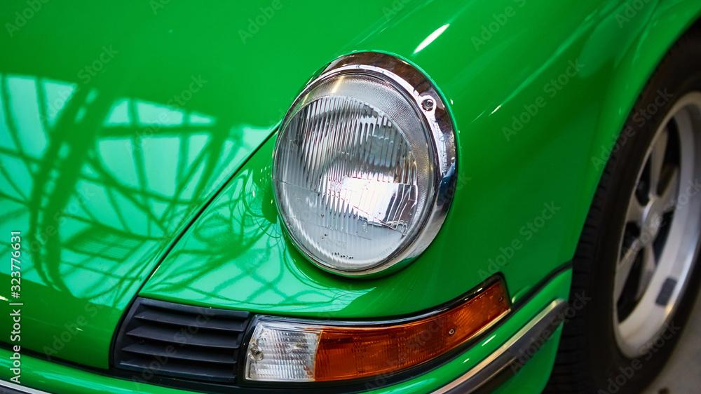 Fototapeta Detail of classic car. Close-up of headlight.