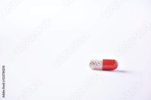 Photo Macro of red capsules on white background